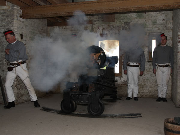 Firing of the 32 pdr SBBL within the North caponier of Fort Nelson