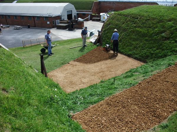 PFS work party laying gravel hogging on the West terreplein Fort Nelson